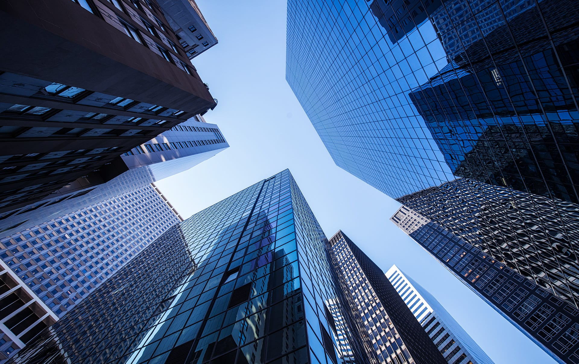 A view looking up at skyscrapers